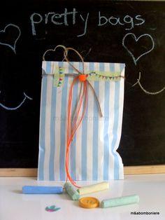 Γαλάζιο ριγέ σακουλάκι με σχοινάκι και πορτοκαλί κορδονάκι. Ένα πορτοκαλί πομ πομ και washi tape. Τιμή: 1,50 ευρώ. Washi, Baby Boy, Scrapbook, Pretty, Handmade, Hand Made, Scrapbooking, Boy Newborn, Handarbeit