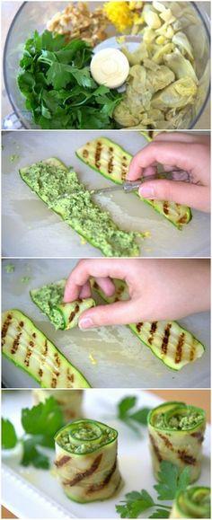 2-3 zucchine cuori di carciofo, scongelati e sgocciolati  scorza di 1 limone Succo di limone 1 cucchiaio 2 spicchi d'aglio, tritati circa una tazza prezzemolo 1/4 tazza di noci pizzico di sale e pepe 1/4 di tazza di olio extra vergine di oliva 1 oncia parmigiano reggiano grattugiato (circa 1/2 tazza) Tagliare zucchine, strisce lunghe e sottili. cospargere su entrambi i lati sale e pepe. Scaldare le zucchine col grill verso l'alto, per circa 30-60 secondi,  Rimuovere i nastri di zucchine alla…