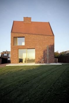 I love the facade of this house. Simple, like a child's conception, yet so compelling with its tilted roof, the carefully detailed upper window, and that broad chimney. Building Exterior, Brick Building, Building A House, Scandinavian Architecture, Brick Architecture, Facade Design, House Design, Modern Farmhouse Exterior, Brickwork