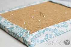 fabric covered cork board! could make it look like art too!