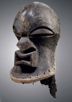 Africa | 'Kifwebe' helmet mask from the Songye people of DR Congo | Wood, fiber and pigment | 19th century