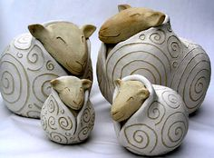 Sheep in Jacket pots hand built by Sue Jenkins