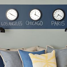 Wall clocks on a color block.