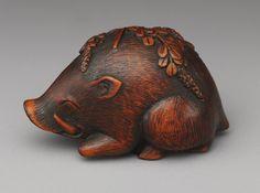 Netsuke: Boar resting on bush clover [Japanese] (91.1.989)   Heilbrunn Timeline of Art History   The Metropolitan Museum of Art