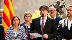Catalonia's President Carles Puigdemont announces the referendum at the Palau de la Generalitat, Barcelona. Photograph: Albert Gea/Reuters