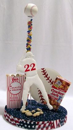 """Out to The Ballgame Centerpiece kit features an 8"""" Baseball, Peanuts, Cracker Jack and Bubble Gum for an all American table decoration. www.awesomeevent.com"""