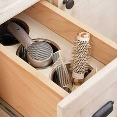 Stainless-steel canisters allow beauty tools to cool safely inside the drawer. More ultimate storage-packed baths: http://www.bhg.com/bathroom/storage/storage-solutions/ultimate-storage-packed-bathrooms/?socsrc=bhgpin082013hairdryer=26