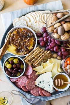 No holiday is complete without a spectacular cheese board. Get ready to WOW your guests with this Holiday Cheese Board with Baked Brie with Bacon Onion Jam and Glazed Pecans. Pecan Recipes, Wine Recipes, Yummy Recipes, Bacon Onion Jam, Glazed Pecans, Baked Brie, Meat And Cheese, Cheese Platters, Quick Snacks