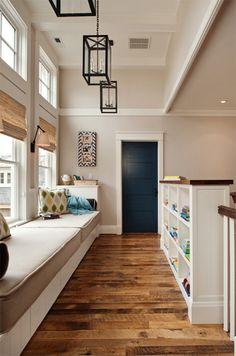 beige hall, built-in window bench, wood floors, blue door, white trim (Sherwin Williams, Bona Fide Beige)