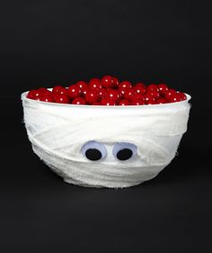 Wrap a white bowl in gauze, toilet paper, or another white fabric to make it look like a mummy.