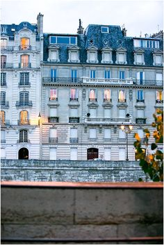 Paris at dusk  | Image One and Only Paris Photography | Read  more http://www.frenchweddingstyle.com/intimate-wedding-for-two-paris/
