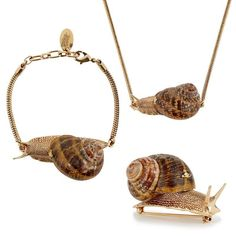 Delving into Vivienne Westwood's jewellery archive, this Spring/Summer 2014 the Snail collection makes a return from the Spring/Summer 2002 Nymphs collection. Quintessentially English, the Snail Necklace, delicately produced from a real snail shell, beautifully creates the suggestion of back gardens after the summer rain. The length of this chain, including the body measures 37.5cm, while the height of the shell measures 3cm.