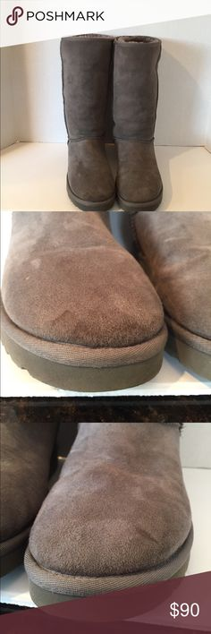Tall Gray Ugg Boots Tall Gray Ugg Boots. Slight wear on right foot toe as seen in pictures above. UGG Shoes
