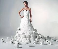 Tasteful or Terrible? No, your eyes are not fooling you. This is a dress made of toilet paper with the rolls...