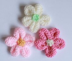 This is a quick and simple flower which can be used to decorate hats, mittens, bags etc. Alternatively it can e made into a brooch by adding a pin to the back.
