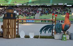 This beautiful cockerel fence is sited right next to the judges' hut and could cause a few spooks Credits: Storm Johnson  Read more at http://www.horseandhound.co.uk/weg/weg-showjumping/weg-sj-gallery/#bpUdlTHchyQ6BMPQ.99 WEG showjumping: fence designs celebrate the best of Normandy [PICS] - Horse & Hound