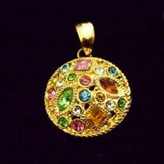 http://www.joiasastrorei.com.br/produto/5737/Pingente-Mandala-Com-Pedras-Coloridas-Folheado-a-Ouro.bz#