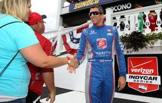 http://www.meganmedicalpt.com/ Justin Wilson, right, shakes hands with a fan prior to Sunday's race at Pocono Raceway. (Matthew O'Haren, USA TODAY Sports)