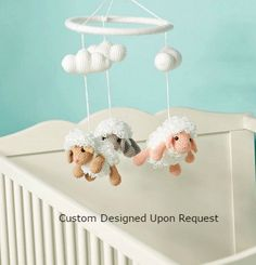 Realistic, characteristic and truly adorable   Featuring 3 x fascinating hand crochet realistic, fluffy and super cute floating farm sheep.....Watch them instantly catch the attention of your child and also adult onlookers.   3 x Fluffy hand crochet Sheep 3 x Clouds    This specially hand crafted baby mobile can be hung on your little ones cot, seat or bedroom mounted and can also be ceiling mounted to add that nursery theme. How are these items made  This baby mobile is handmade with love…