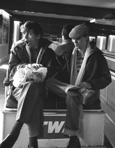 David Bowie +Iggy Popp at London Airport on a TWA buggy in 1977.