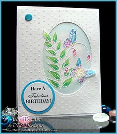 handmade birthday card ... main image embossed on vellum with white ... bright colors for the butterflies and leaves colored with markers behind ... like how it fits in the negative oval space but overlaps slightly with the leaves and butterfly ...