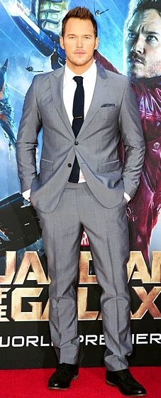 Chris Pratt looked superhero fit in a Sand Copenhagen grey suit with a light pink shirt and navy tie, paired with a Chopard Mille Miglia watch and a polka dot pocket square.
