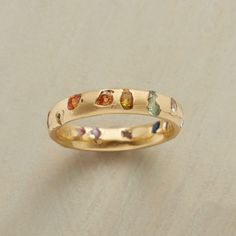 SEVERN VALLEY RING--Randomly placed multicolored sapphires dot matte 18kt gold like wildflowers on a riverbank. Each ring is hand cast with stones in place for a distinctive outcome. By Polly Wales. Whole sizes 5 to 9.