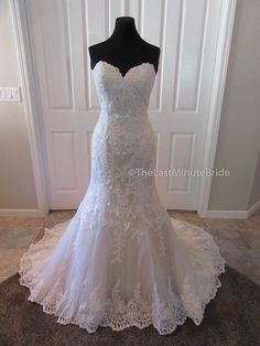 Description Make a statement with this fit and flare wedding dress with a beautiful sheer lace back with corset detailing and lace appliques. The dress has a flattering sweetheart neckline, crystal bu