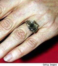 Camilla was given an 8 carat, emerald-cut diamond engagement ring by Prince Charles. The ring was a Windsor family heirloom that belonged to Queen Elizabeth. It has a 1920s platinum setting with three diamond baguettes on each side.