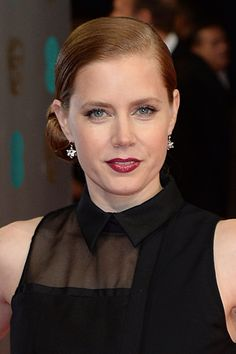 For the sophisticated bride looking for a slightly sexy twist, take a note out of Amy Adams' beauty book: A side-parted, slicked back chignon, romantic red lips and lashings of mascara