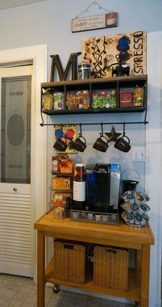 My new coffee bar! :)  Shelf is from Hobby Lobby: http://shop.hobbylobby.com/products/metal-and-wood-shelf-with-baskets-and-7-hooks-263558/
