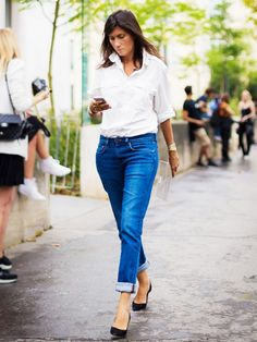 Emmanuelle Alt in a button-down, cuffed jeans, and black pumps