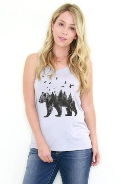 """Details     Relaxed fit tank top with scoop neck, racerback, and forest bear graphic. 95% Rayon 5% Spandex       Content + Care - 95% Polyester 5% Rayon - Hand Wash. Hang Dry. - Imported Size + Fit   - Relaxed Fit  -Model is 5'4"""" and wearing a Small - Measurements from a size Small - Full length: 26"""" - Chest: 28"""" - Waist: 36""""  Shop This Look"""