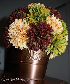 """CHEAP & EASY FLOWER TOPIARY  Materials:   silk flowers {about 25, which for me was 3 stems}  6"""" styrofoam ball  hot glue and glue gun  some type of base to display it on/in"""