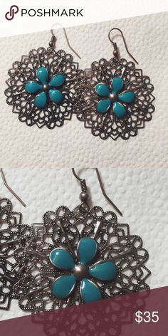 Vintage flower earrings ⋈ Dark gray/gunmetal color with a teal flower in the center ⋈ Some imperfections/discoloration as shown because they are handmade ⋈ Price is negotiable! Vintage Jewelry Earrings