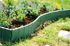 Plastic landscape edging is an inexpensive but durable material as landscape bordering which will add decorative feature for the better … Plastic Garden Fencing, Plastic Landscape Edging, Landscape Borders, Flower Bed Edging, Flower Beds, Patio Fence, Lawn Edging, Garden Decor Items, Garden Trellis