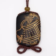 A three case lacquer inro worked in gold and coloured taka-maki-e, the temple bell decorated with tennin in flight, and tasseled cord on a roiro ground.  Signed Jokasai.  Length 9.6cm.  Circa 1820.  With ivory manju netsuke carved with a ho-o.