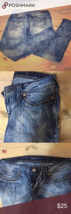 Levi jeans Demi curve low rise skinny Nice acid wash, bronze zipper design on front and back pockets . Great fit and comfortable Levi's Jeans Skinny