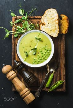 Fresh homemade pea cream soup served with grilled bread by Anna Ivanova on 500px