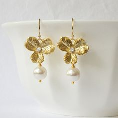Gold Flower Pearl Drop Earrings by PeriniDesigns on Etsy