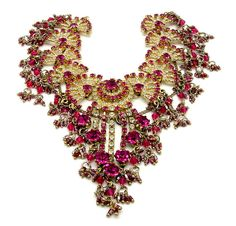 vintage 1960s drippy bib rhinestone necklace done in fuchsia and clear stones.