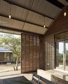 Timber sliding door for the balcony  A Cost-Effective Factory-Built House with Lake|Flato : Remodelista