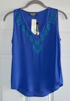 "April 2016 Stitch Fix. Papermoon Paola Embroidered Neckline Top. 100% soft rayon, pretty blue/purple with teal embroidery. Petite measures 23"" long.  https://www.stitchfix.com/referral/4292370"