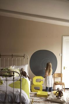 a circle (or partial circle) of chalboard paint on one wall would be awesome for to-do lists!