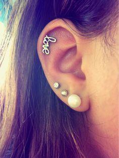 Love ear piercing where the love earring is