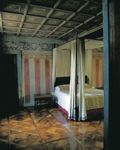 Simple linen bed hangings offset the Renaissance architectural details of a bedroom in Oderzo. Roberto Peregalli