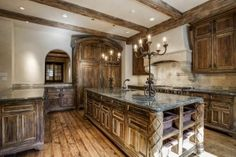 Beautifully aged look in this Old World style Kitchen in Dallas