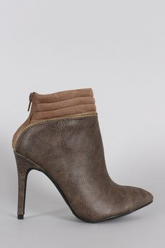 "Description These classic  pointy toe  silhouette, quilted vegan suede cuff with zipper detailing, and wrapped stiletto heel. Finished with cushioned insole and rear zipper closure for easy on/off.Material: Vegan Leather/Vegan Suede (man-made)Sole: Synthetic  Measurement Heel Height: 4"" (approx)Shaft Length: 7.75"" (including heel)Top Opening Circumference: 8.5"" (approx) 