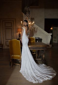 Love the shape and fabric and low back  http://www.wantthatwedding.co.uk/2014/12/02/sultry-sexy-wedding-dresses-2015-the-berta-bridal-collection/