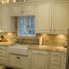 A Houzz.com favorite! This off-white kitchen displays what most homeowners are looking for: a transitional design, granite counters and an inviting island! Greenfield Cabinetry . IL . WI . MN . Dresner Design Chicago, IL Scott Dresner (312) 929-6444 DresnerDesign.com #GreenfieldCabinetry #CustomCabinetry #ChicagoCustomCabinetry #ChicagoDesigner #DresnerDesign #ScottDresner #ChicagoKitchenDesigner #KitchenDesigner #Trend #BrickBacksplash #GraniteCounters #WhiteKitchen
